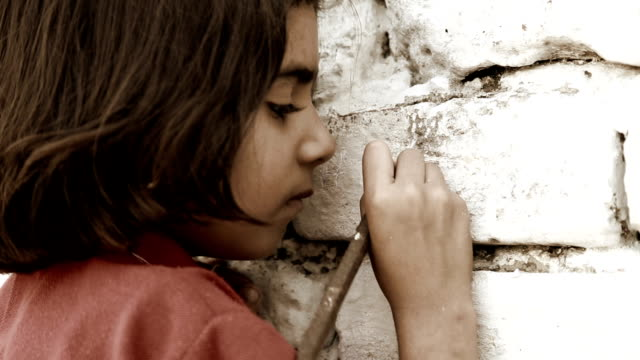 Little Girl Writing on Wall