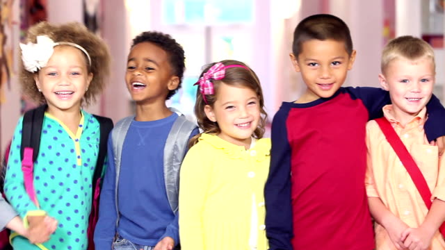 little girls and boys standing in a row at school - primary school child stock videos & royalty-free footage