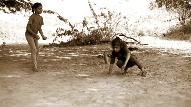 little girls playing marbles - sepia stock videos and b-roll footage