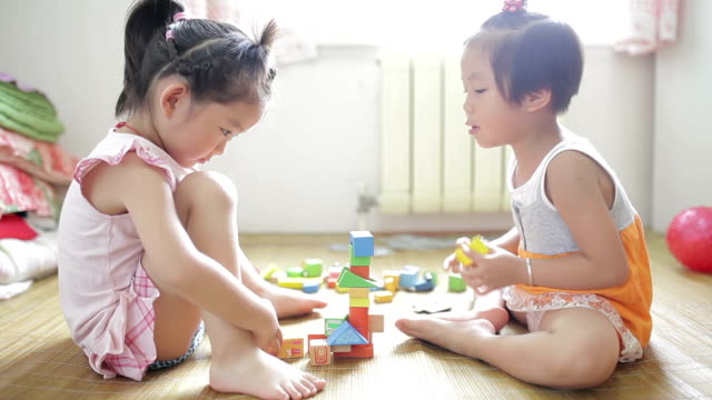 Little girls playing with blocks at home /Xi'an, Shaanxi, China