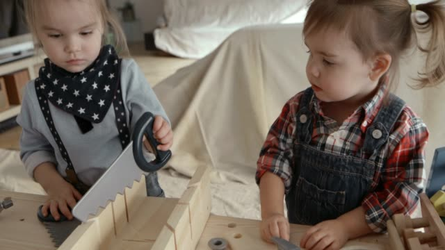 4k - little girls renovation construction playing living room - toolbox stock videos and b-roll footage