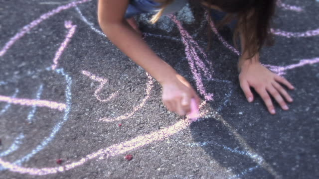 ms tu little girls running, jumping and playing and one girlis drawing hopscotch  on sidewalk / langley, british columbia, canada.  - imagination stock videos and b-roll footage