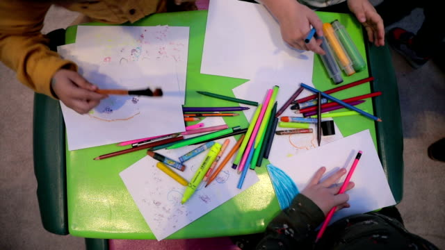 little girls sketching and drawing in a preschool classroom - art class stock videos and b-roll footage
