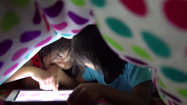little girls using tablet - bed sheets stock videos & royalty-free footage