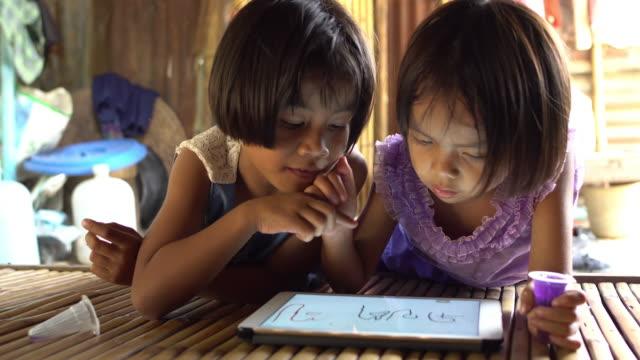Little girls using tablet