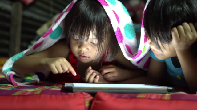 little girls using tablet - blanket stock videos and b-roll footage