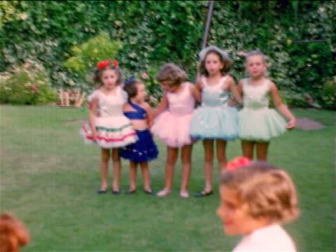1953/54 HOME MOVIES little girls with ballerina costumes singing + swaying on lawn