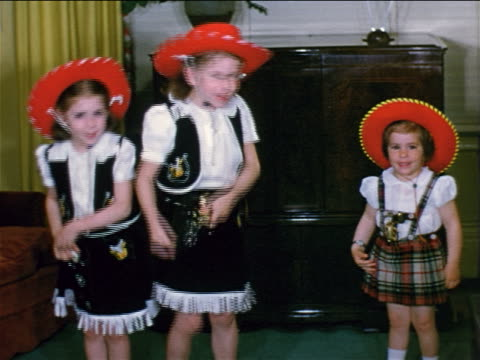 1952 HOME MOVIES 3 little girls with cowgirl costumes dancing around living room