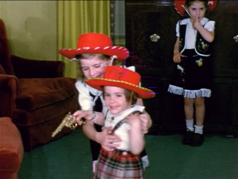 1952 home movies 3 little girls with cowgirl costumes playing in living room - 1952 stock videos & royalty-free footage