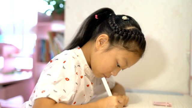 vídeos de stock e filmes b-roll de little girls writing their homework for elementary school - 8 9 anos