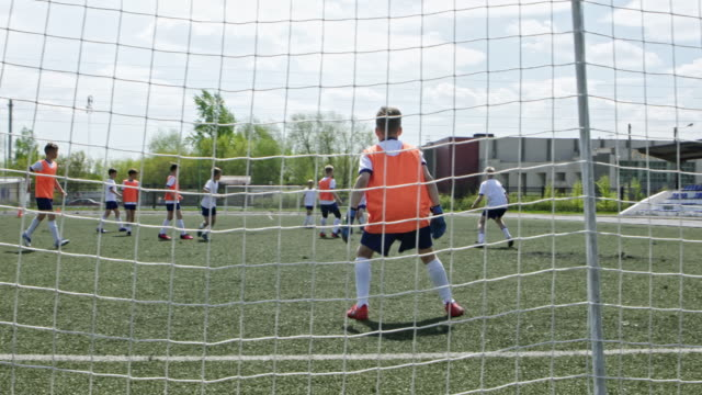 little goalie missing the ball - tor konstruktion stock-videos und b-roll-filmmaterial