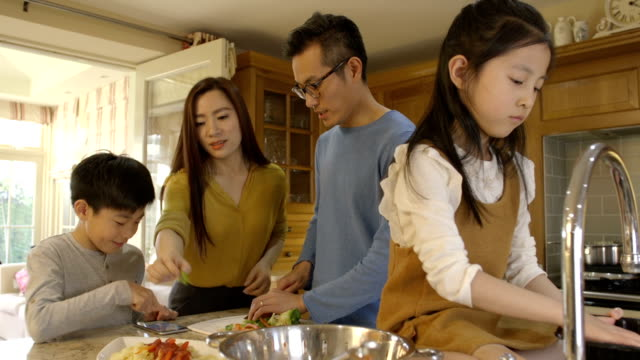 little helpers at dinner time - east asian ethnicity stock videos & royalty-free footage