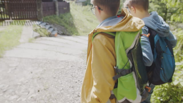 little hikers using solar cells on backpack - portability stock videos & royalty-free footage