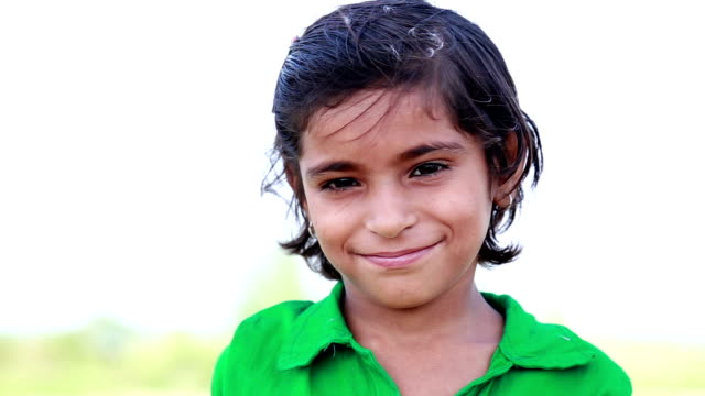 little indian girl smiling - headshot stock videos & royalty-free footage