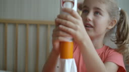 Little Kid Girl Building Mars Landing Mission Rocket. Education Science. Creative Child Playing With Toy Space Rocket. Child Dreamer Playing With Toy Space Rocket.
