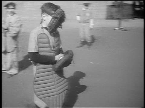 b/w 1941 pan little league baseball catcher walks to pitcher, shows him ball + lectures him / nyc - youth baseball and softball league stock videos and b-roll footage
