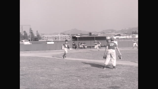 ws pan little league baseball game, batter hts triple / united states - youth baseball and softball league stock videos and b-roll footage