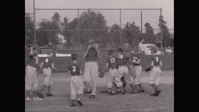 ws pan little league baseball game, batter strikes out / united states - little league stock videos and b-roll footage