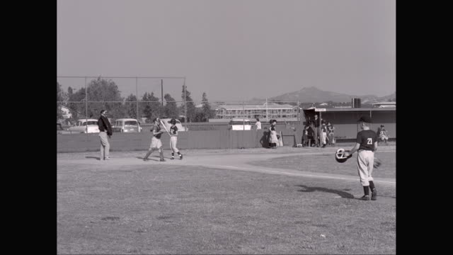 ws pan little league baseball game, pitcher throwing, catcher throwing back / united states - little league stock videos and b-roll footage