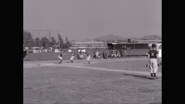 ws little league baseball game, two runners scoring / united states - little league stock videos and b-roll footage