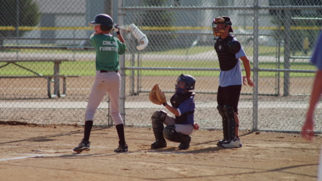 little league baseball practice in a small town. shot features a batter at the plate and a catcher. pitcher throws a strike! - small town stock videos & royalty-free footage
