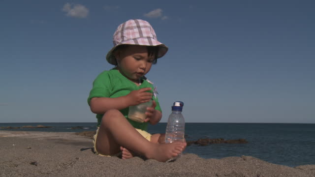 little metis girl eating biscuit. - one baby girl only stock videos & royalty-free footage