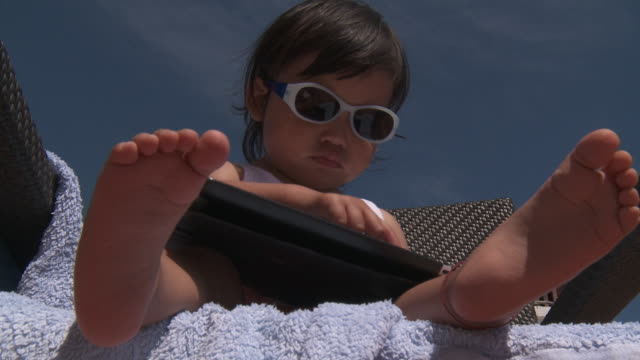 little metis girl playing with digital tablet - one baby girl only stock videos & royalty-free footage