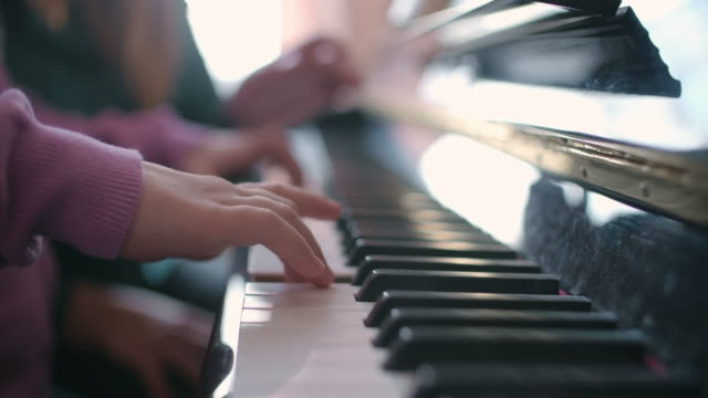 little piano player - concentration stock videos & royalty-free footage