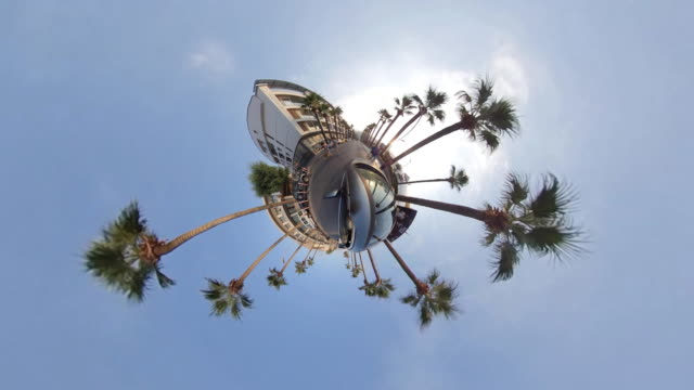 little planet - car in the tropical city - fish eye lens stock videos & royalty-free footage