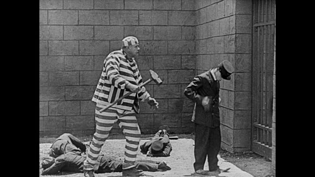 1920 little prison guard (buster keaton) orders around big convict (joe roberts) - bullying stock videos & royalty-free footage