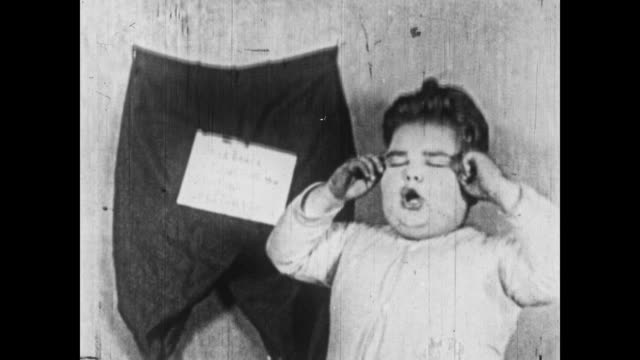 1926 a little rascal boy finds a substitute for a christmas stocking - stockings stock videos & royalty-free footage