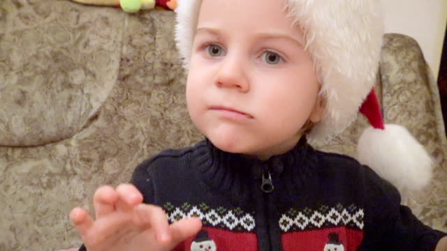 little santa eating a walnut and playing with doll - walnut stock videos & royalty-free footage