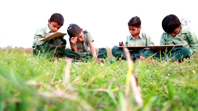 little school children reading in uniform - schoolgirl stock videos & royalty-free footage