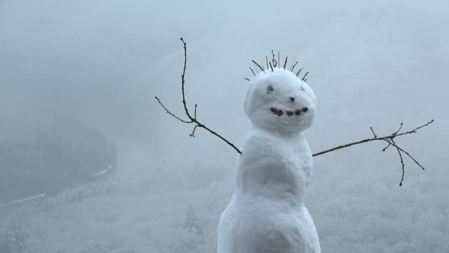 Little snowman at viewpoint Cloef, Mettlach-Orscholz, Saar Valley, Saarland, Germany, Europe