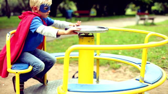 Little Superhero spinning on the carousel.