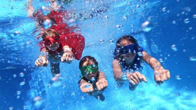 little superheroes flying underwater - girl swimming costume stock videos & royalty-free footage