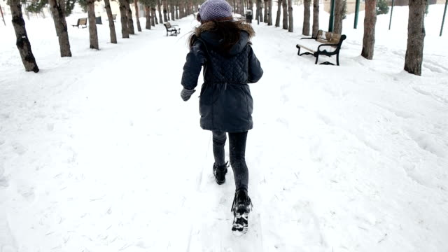 little sweet girl running in a snowy park - mitten stock videos and b-roll footage
