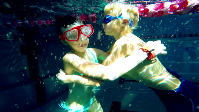 little swimmers embracing - sister stock videos & royalty-free footage