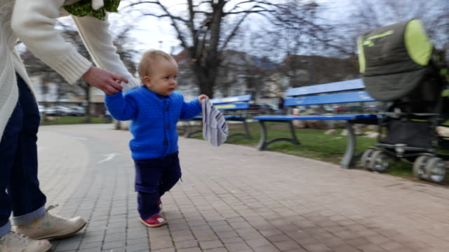 Little toddler boy making his first steps