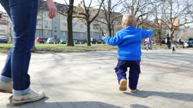 little toddler boy making his first steps - gripping stock videos and b-roll footage