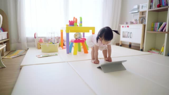 little toddler girl using digital tablet at home - one baby girl only stock videos & royalty-free footage