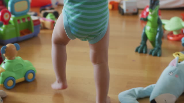 little toddler legs of a baby boy walking on floor at home in slow motion - first steps stock videos & royalty-free footage