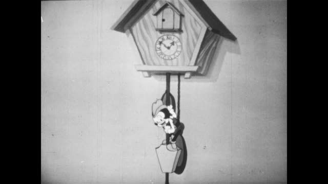 little tom thumb jumps onto cuckoo clock pendulum / cuckoo goes crazy and exhausts himself - cuckoo stock videos and b-roll footage