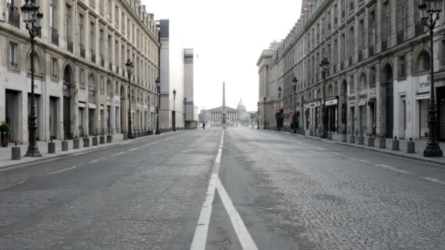 stockvideo's en b-roll-footage met little traffic goes by rue royale which ends at the place de la concorde during citizen movement restrictions and coronavirus containment measures on... - rue royale