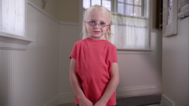litttle blond girl with cochlear implant standing in a hall way - disability stock videos & royalty-free footage