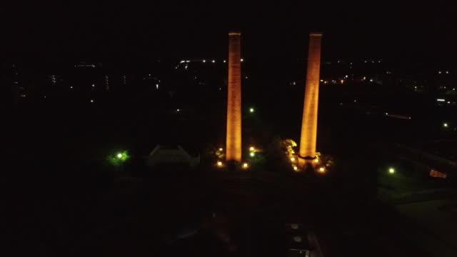 aerial, lit-up twin chimneys, fukuoka, japan - fukuoka prefecture stock videos & royalty-free footage
