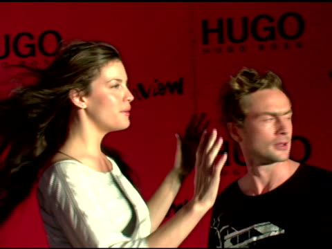 liv tyler with royston langdon of arckid at the arckid at hugo boss private concert series at hugo boss roof deck in new york, new york on august 2,... - hugo boss stock videos & royalty-free footage