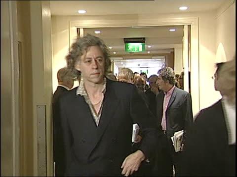 live 8 lineup controversy tx sir bob geldof towards followed by richard curtis sir elton john next midge ure - bob geldof stock videos & royalty-free footage