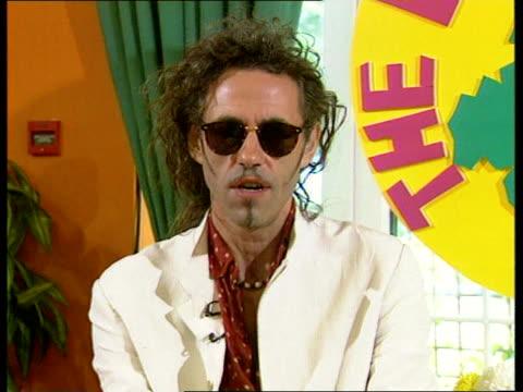 stockvideo's en b-roll-footage met 'live aid' concert 10th anniversary england london int bob geldof interview sot reporter - bob geldof
