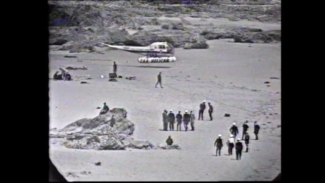 live broadcast search for missing prime minister harold holt – presenter vo cheviot beach surf and waves / taa helicab chopper lands on beach as... - live broadcast stock videos & royalty-free footage